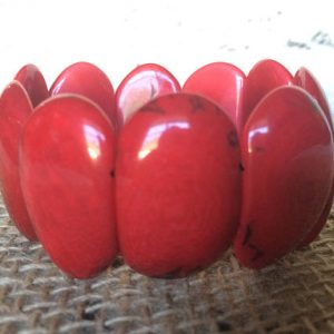 RED TAGUA NUT STATEMENT BRACELET