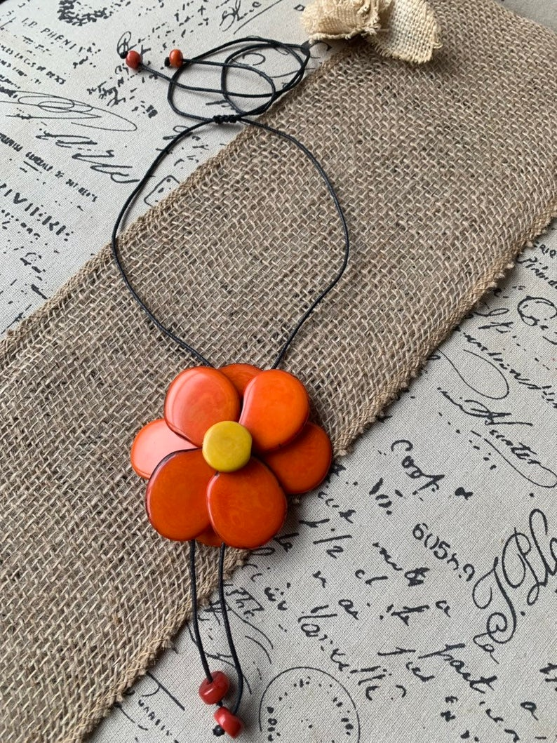 Orange flower tagua pendant