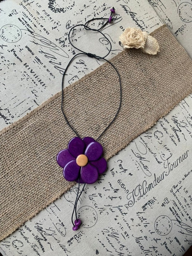 purple flower tagua pendant