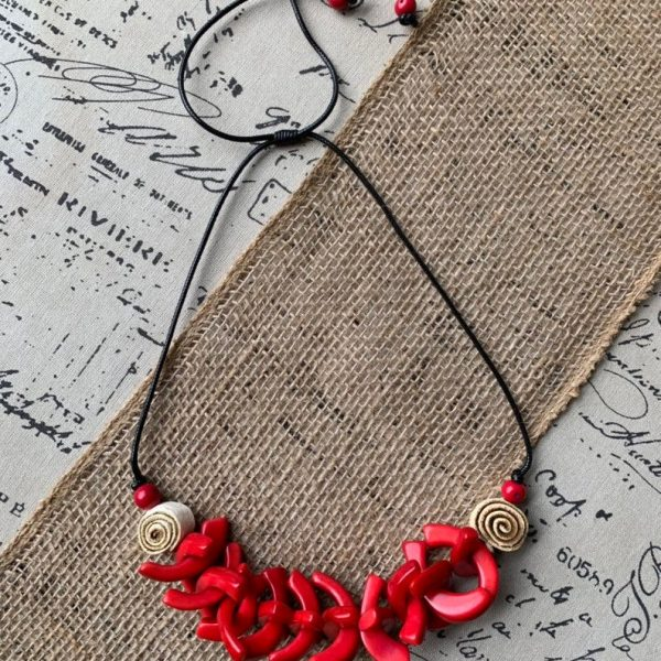Red tagua necklace with orange peel flower